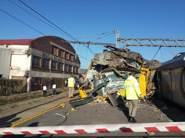 METRORAIL CRASH: Metroplus carriages crashed into a building and another onto a platform. Photo: Illanit Chernick