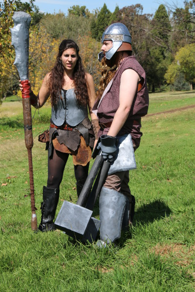 LIVE ACTION: Kara Úlfhéõnar, played by the author, and Drogar Thromek Úlfhéõnar, played by Ryan Young, take over a village with their adventuring group at a LARPING event.
