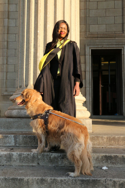 STRONGER: Sisanda Msekele and her guide dog Romy on the steps of Great Hall after her graduation at Wits University yesterday. Photo: Samantha Camara.
