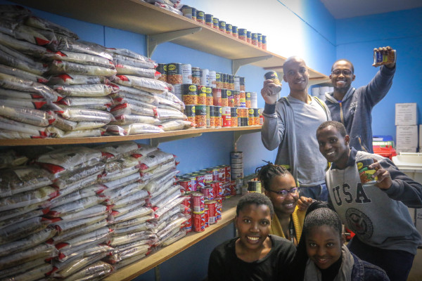 FULLY-STOCKED: The Wits Food Bank recieved two of its biggest food donations from the Wits Junction House Commmittee, the SRC and the WCCO last week Friday. Volunteers at the food bank spent the week unpacking the food items to help students in need. Photo: Riante Naidoo.