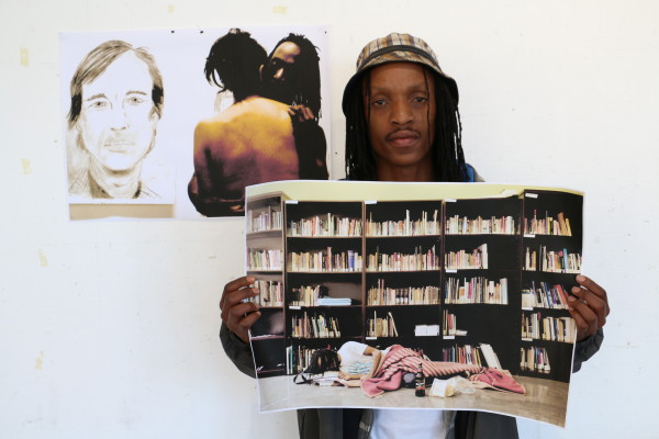 TRANSFORMATION AT WITS: Sithembiso Khalishwayo, winner of this year's photographic competition stands with his two submitted pieces. One was on interracial love and the other touched on one of the issues that Wits students face.