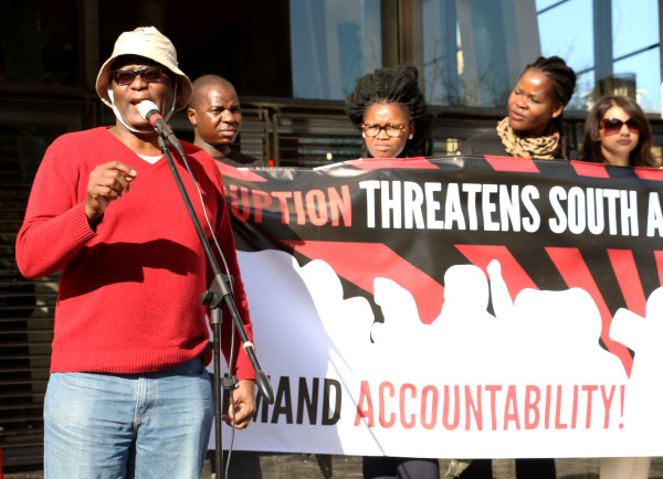 Former Cosatu Secretary General, Zwelinzima Vavi  addresses the masses outside the Constitutional Court in Johannesburg. Photo: Boipelo Boikhutso.