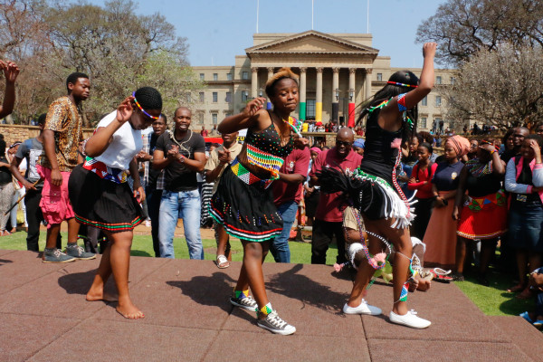 LAHL'UMLENZE: Zulu students perfoming ingoma at the Wits Library Lawns on Wednesday during the Heritage Day celebration. The Students Representative Council (SRC) organised a competition for five societies to showcase their traditional dance, songs, food and outfits. The Tsonga's Khomanani Vatsonga Society won the competition by charming the audience with their makwaya and xibelani dances. Photo: Sinikiwe Mqadi.