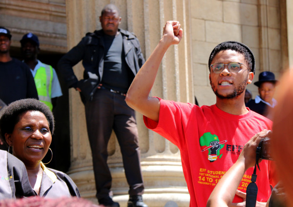 Amadla!: Wits EFF Student Command leader Vuyani Pambo addressing protesting students and workers outside the cordoned off Great Hall. Photo: Michelle Gumede