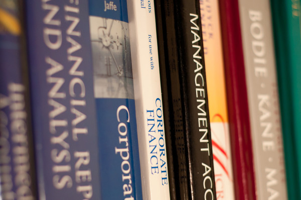 Stock image of textbooks by John Liu from Los Angeles, USA, via Wikimedia Commons