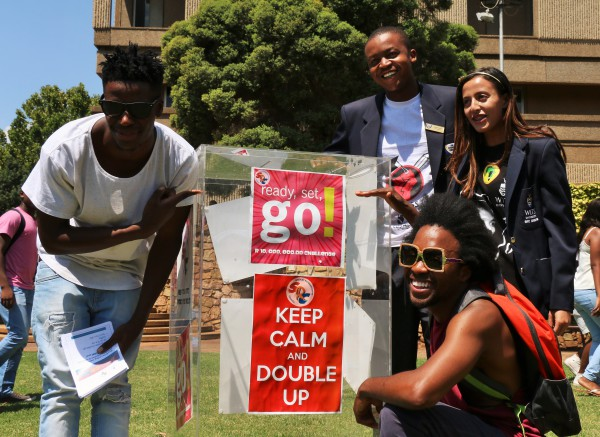 FILL IT UP: Local rapper iFani, SRC secretary general Fashia Hassan, SRC Projects, media and campaigns manager Mzwanele Mtshwani and SRC deputy secretary general Thabo Boom (from right) at the #DoubleUp lunch hour event on campus where they encouraged students and staff to donate towards the Fill-Up the Jar initiative. Photo: Tanisha Heiberg