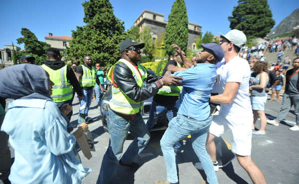 CAPE TOWN, SOUTH AFRICA – FEBRUARY 17: Students clash with security guards during a protest at the University of Cape Town on February 17, 2016 in Cape Town, South Africa. Students continued with their protest against the shortage of student accommodation at the university. (Photo by Gallo Images / Die Burger / Lulama Zenzile)