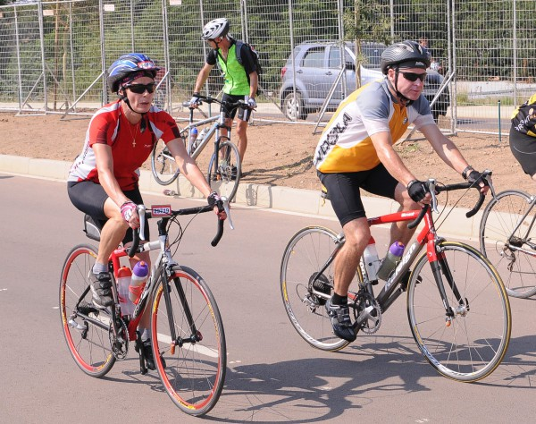 Dr Johan Swanepoel (left) and his wife cycling. Photo: Provided