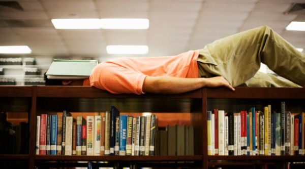 ALL WORK AND NO PLAY: Students often fall asleep from boredom or from not having had enough sleep the night before. But for some the library is the only safe place they can sleep while finishing their degrees. Photo: survivingcollege.com