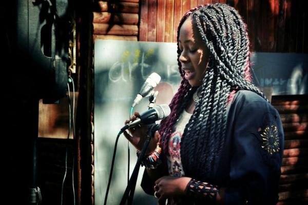 "Poet and Co-founder of "" We Original Kreatif and Enlighted (WOKE), an arts movement, Rhema Stephani Namakau Socika"