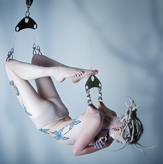 CONTENT AND ELEGANT: Lucia Martinengo is suspended from a total of sick hooks and has been positioned to display a scorpion for her first body suspension Photo: Provided by Pendeo