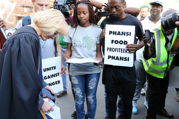 PHANSI: Wits Inala Forum members look on as Registrar Carol Crosley signs the memorandum, Photo: Mokgethwa Masemola