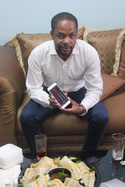 Touch, let's go: Karabo Masenyadiloana presents the the smartphone prototype                                                                                                                                   Photo:  Provided