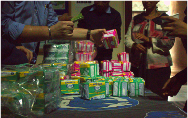 Sanitary pads being purchased at the entrance to donate to students Photo: Aarti Bhana