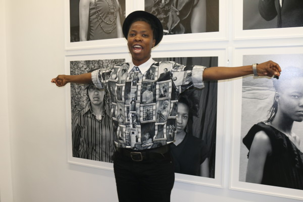 Behind the lens: Photographer Zanele Muholi wears a shirt with faces of series participants. Photo: Olwethu Boso