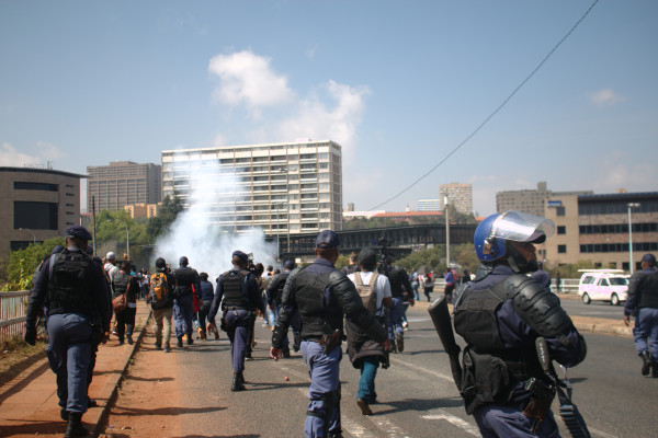 DAY 2: Police throw stun grenades at Wits Fees Must Fall protesters Tuesday September 20, 2016. Photo: Nasya Smith