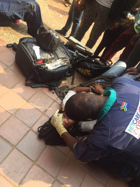 Photo by Thando Moyo. Student treated after being pepper sprayed.