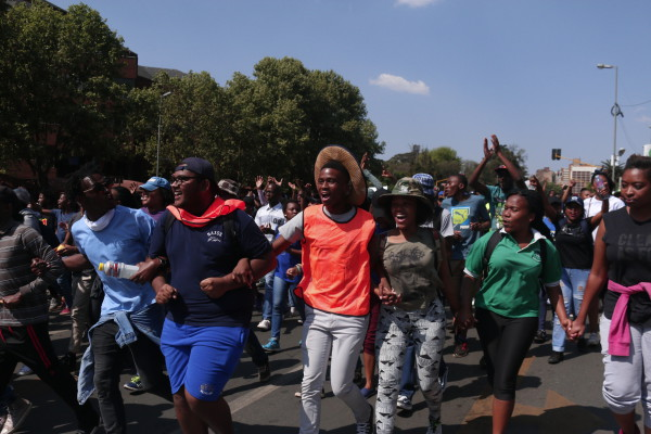 A GOOD DAY: Protesters sing and dance as the march is peaceful and non-violent. Photo: Nasya Smith