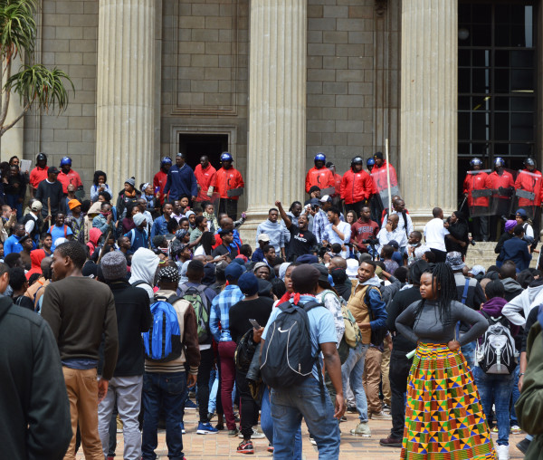 Students gather around the steps of the Great Hall to listen to former SRC president Mcebo Dlamini. Photo: Laura Pisanello