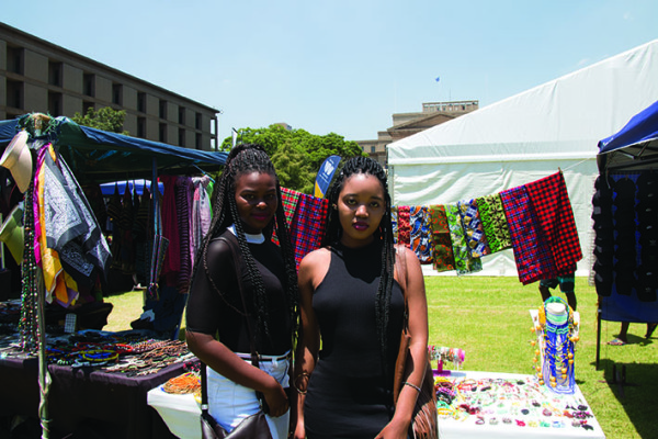 Young Buds: First year commerce students, Sindi Mahlangu and Hlonipho Nalana atthe library lawns flea market. Photo: Lwandlie Fikeni