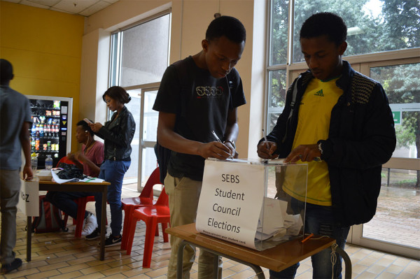 Two students cast their vote at the New Commerce Building for the school council elections