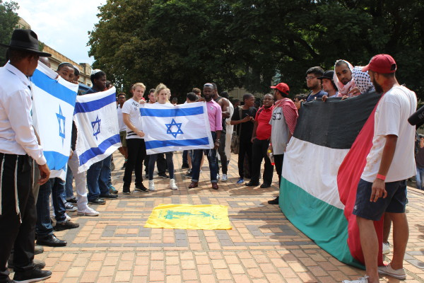 STAND OFF: Tensions over Israeli's occupation of Palestinian land were replicated on campus when opposing camps laid claim to the piazza. Photo: Aarti Bhana