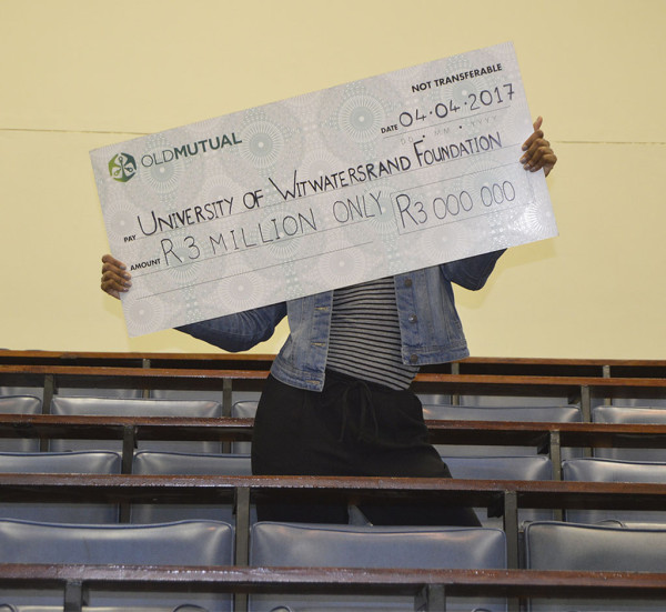 Old Mutual hands over a R3-million cheque, donating to the missing middle. Photo: Nomvelo Chalumbira