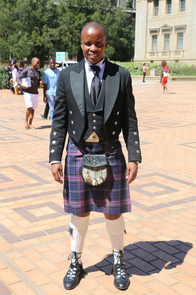 STANDING OUT: Thabo Makuru stands proudly in his Scottish inspired attire after obtaining his Bachelor of Law degree after 8 years. Photographer: Patricia Aruo