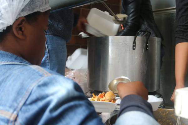 WCCO volunteers dish out warm meals while studnets queue up in numbers during lunch time