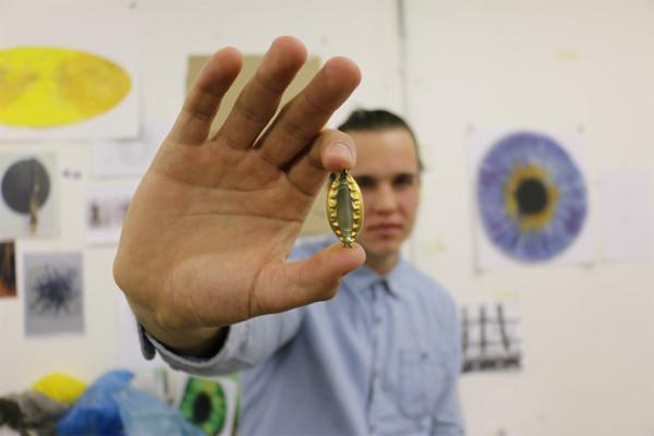 Chris Soal uses bottle caps for his art work