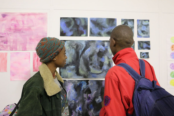 Attendees marvellling at the creative work of Fine Arts students