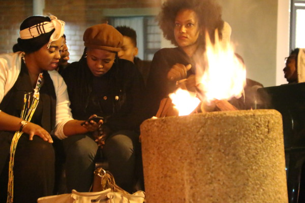 From left , Miseka Gaqa IPhupho l'ka Biko vocalist & friends , gathered around a fire at the Jazz and poetry session.