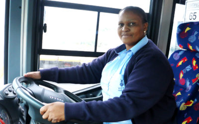 FIRST WITS WOMAN BUS DRIVER OPENS DOORS