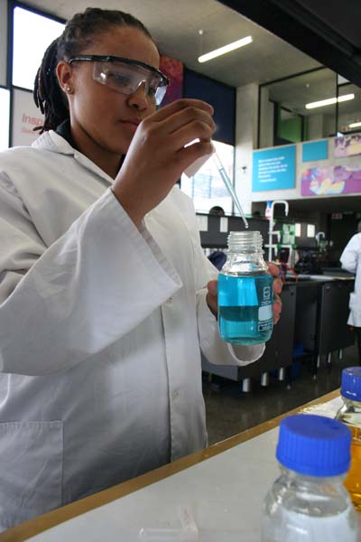 A student conducting a chemistry experiment at the Wits Science Stadium. The university has psycho-social programmes to identify and nurture learners from disadvantaged high schools who show promise in science and mathematics. Photo: Tanyaradzwa Nyamajiya