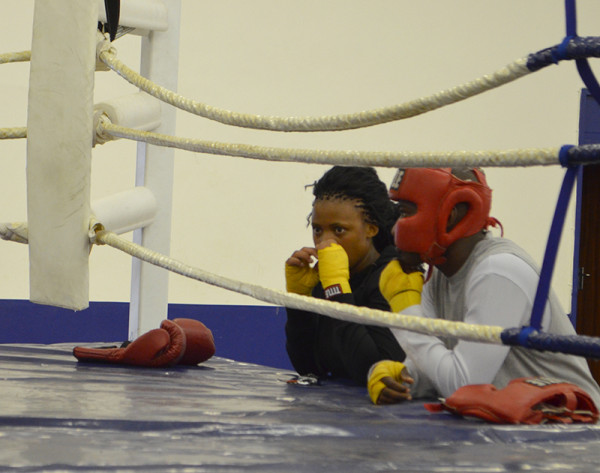 THOUGHTFUL PUNCH: Lungile Duma, left, strategises ringside.  Photo: Pheladi Sethusa
