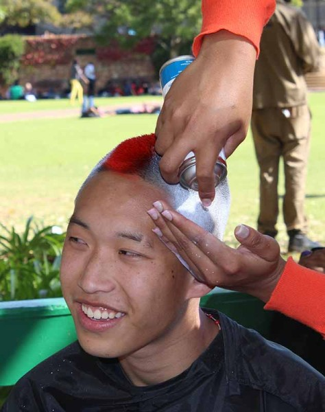 Adrian Song, first year Biokinetics health science, decided to spray his hair in support of the Shavathon.