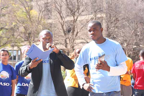Accused: Project W member Jamie Mighti pictured here with Henry Masuku  may have legal action taken against him.