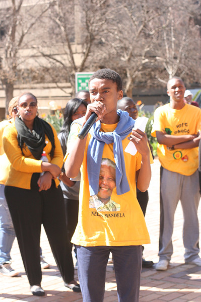 Progressive Youth Allience candidate Mbe Mbhele telling students at an SRC election circus about evenrthing the SRC has done for students, including buses to Bree.