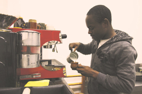 """""""Another one garçon"""": Howard Hamandishe is one of the barrista's at HEI trained by fellow Braamfontein coffee shop Post"""