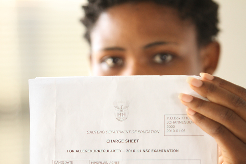 ACCUSED NUMBER 35: Elizabeth Mpofu displays the charge sheet that her accounting exam had an irregularity. Photo: Mia Swart