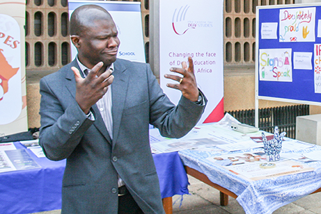 """I CAN SIGN: Wits Language School are hosting  """"So you think you can sign"""" a song-sign translation competition as part of  Deaf Awareness Month ending September 30th. Lecturer Lucas Magongwa demonstrates good sign technique at the deaf awareness display on Tuesday afternoon at Education campus.  Photo: Palesa Radebe"""