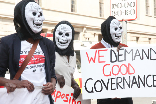 Protesters wore masks to conceal their identities in fear of being victimised if identified. Photo: Pheladi Sethusa