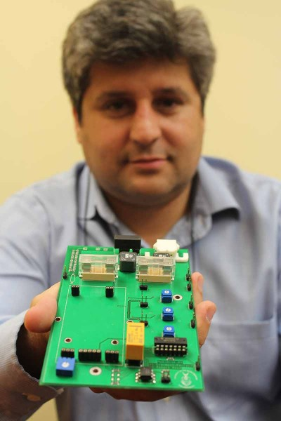 Prof Bruce Mellado from the High Energy Physics group at Wits displays the processing unit the group is building for a new super computer. Photo: Mia Swart