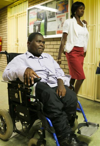 MAKING IT THROUGH: Second year BCom PPE, Brian Sibanda, a paraplegic, makes his way to class. Photo: Luke Matthews