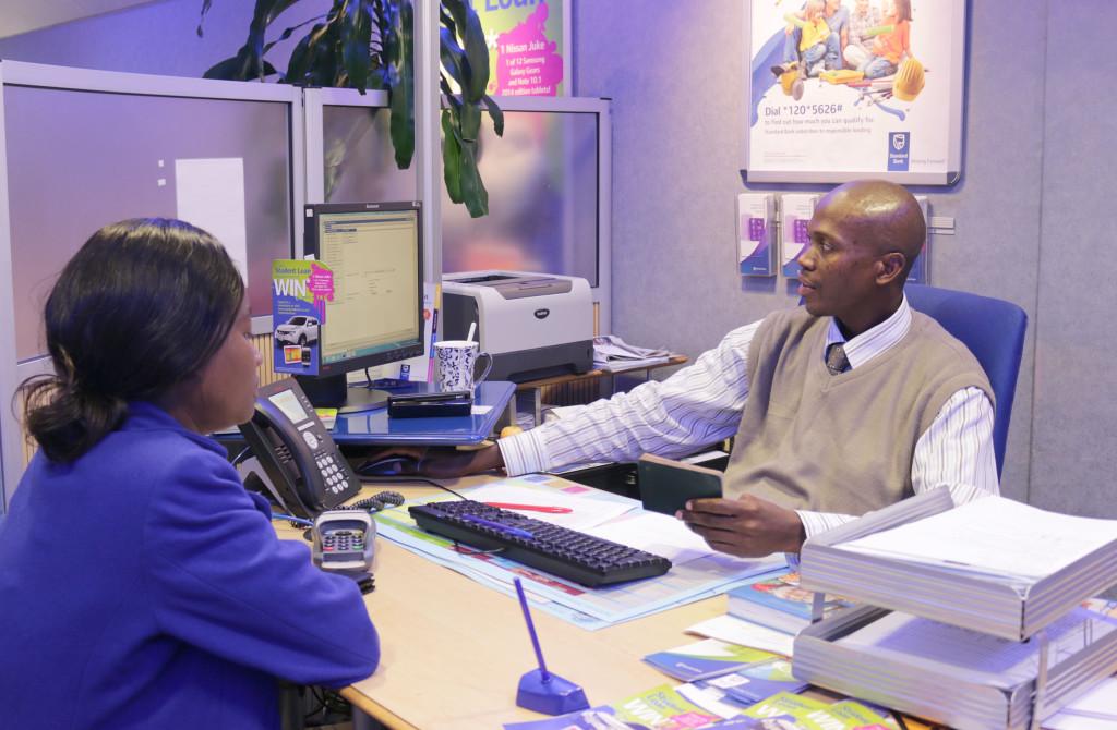 Necessary Advice : Bank consultant assisting student with investment options. Pictured: Ngwako Mafokane, Tatenda Chikomba Photo: Thabile Manala