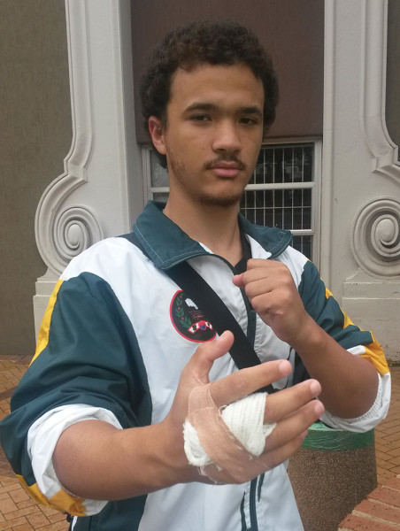 BATTLE SCARS: Kim Lucas' hand got injured during a sparring event, but he managed to bag a silver medal for sparring at the South African Championships held last weekend. Photo: Lameez Omarjee