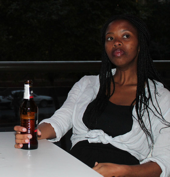 MORE REFRESHMENT: Wits Vuvuzela's Anazi Zote sitting at Vuyo's enjoying a refreshing beer after a long day in class.                                        Photo: Luca Kotton