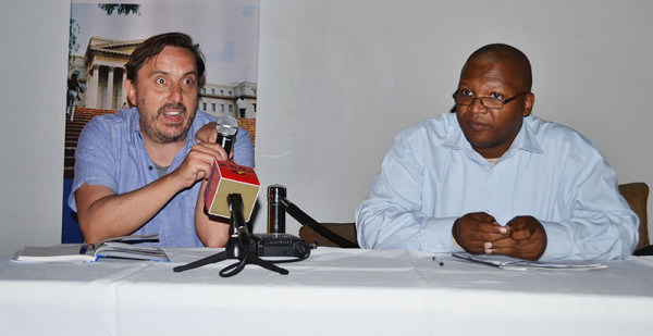 PRIVATE MATTERS:  Dr Christoph Hermann and Prof. Christopher Malikane answer questions posed by audience members.  Photo: Lameez Omarjee