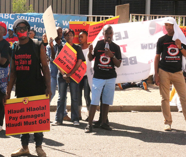 Protesters taped their mouths in protest against censorship. Photo: Lutho Mtongana