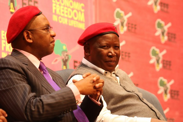 """CALM BEFORE THE LAUNCH: Advocate Dali Mpofu and Economic Freedom Fighters (EFF) leader Julius Malema sitting on the Great Hall stage of Wits University during the launch of the EFF book """"The Coming Revolution"""" on Thursday, July 25, 2014. Photo: Luke Matthews"""